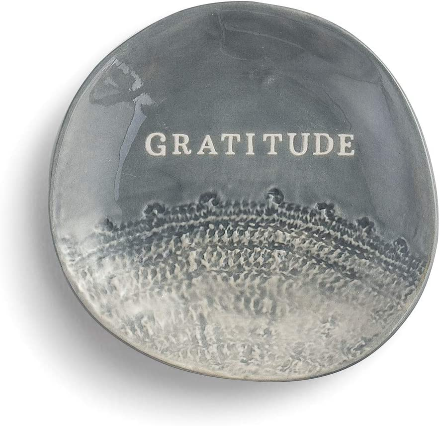 "This is an image of a jewelry holder in gray color with ""Gratitude"" word printed across."