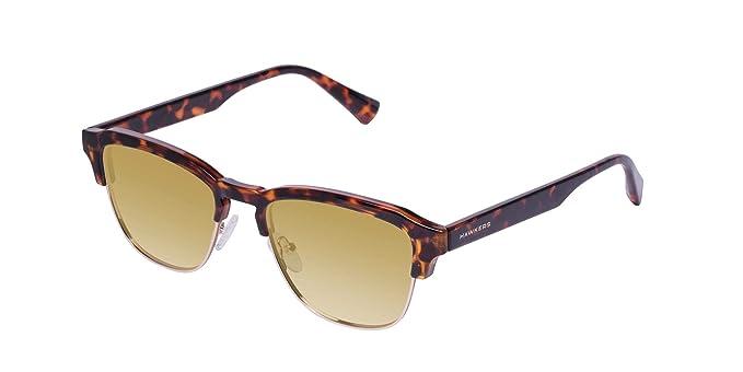 44ed56105e HAWKERS · CLASSIC · Brown · Gold · Gafas de sol para hombre y mujer:  Amazon.es: Ropa y accesorios
