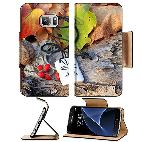 Luxlady Premium Samsung Galaxy S7 Flip Pu Leather Wallet Case IMAGE ID: 34628313 Ethnic handmade bone magic african amulet on autumn style background