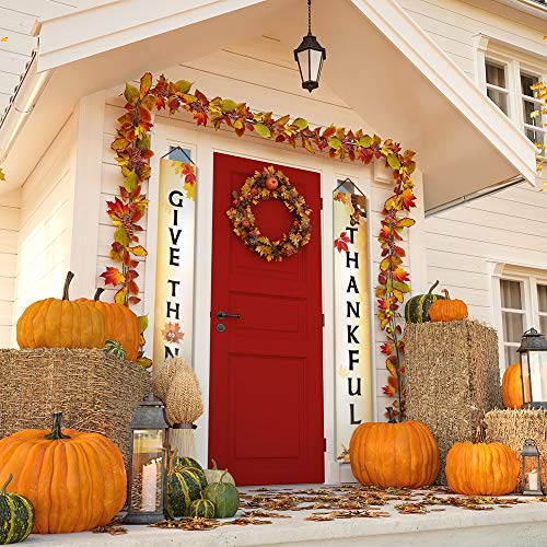 Beautiful Front Porch with Red Door decorated with pumpkins and Thanksgiving banner