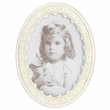 Marco ovalado para foto con efecto envejecido en blanco y adornos en relieve alrededor