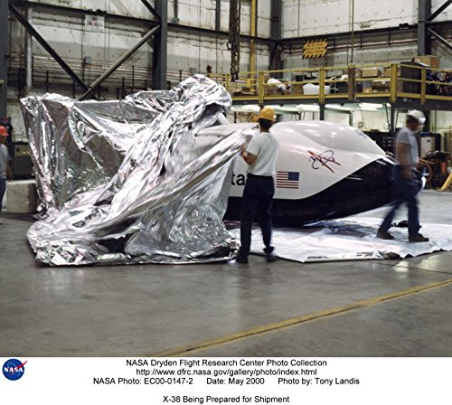 technicians-prepare-the-x-38-research-vehicle-for-shipment-in-a-dryden-flight-research-center-hangar
