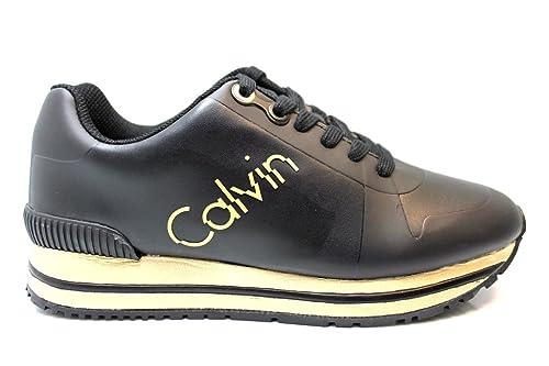 Calvin Klein Sneakers Donna Tabitha Rub Smooth R0654 Nero Oro Scarpa  Sportiva Impermeabile  Amazon.it  Scarpe e borse 3e6279f6852