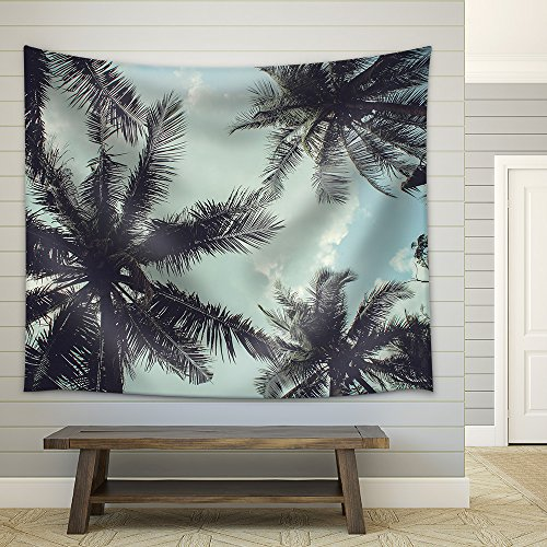 Branches of Coconut Palms Under Blue Sky Fabric Wall