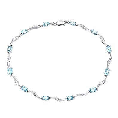 Revoni 9ct White Gold Blue Topaz and Diamond Wave Link Bracelet 7QiwH8Lgk