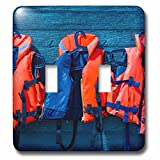 3dRose Alexis Photography - Objects - Water safety goes first. Orange life saving jackets on a blue wall - Light Switch Covers - double toggle switch (lsp_267156_2)