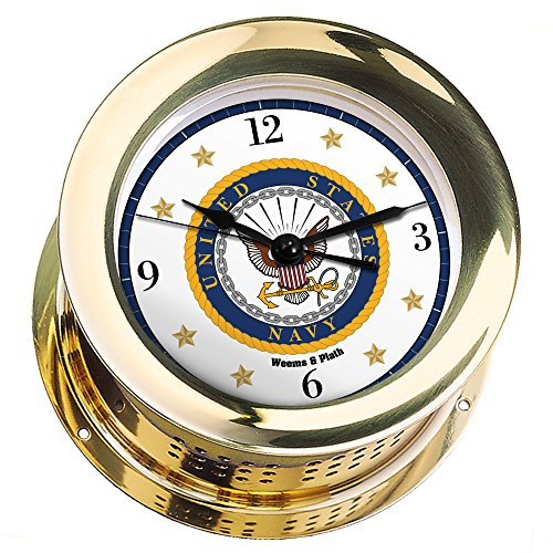 is Brass Quartz Ship's Bell Clock #NV200100 01A (#7 Emblem Printed in Full Color with Black Numbers, Gold Stars, and Navy Blue Border) ()