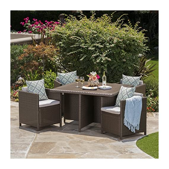 "Pueblo Outdoor Wicker 5Pc Dining Set w/Water Resistant Cushions (Brown/Ceramic Grey) - This wicker wrapped outdoor dining set is ideal for any patio or back yard. Enjoy eating with the family on those gorgeous summer nights, dining in both comfort and style. The iron frame of this set insures that your dining set will both last as well remain sturdy during heavy use. The water resistant fabric allows you to dine in the security that if you spill a little bit, it is both easy to clean and won't ruin you patio furniture. Includes: One (1) Dining Table and Four (4) Dining Chairs Table Dimensions: 48.03""D x 48.03""W x 29.13""H 