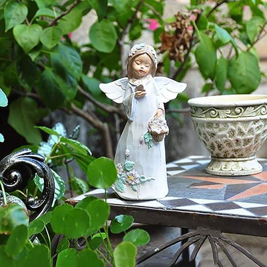Estatua del ángel De Hadas Figuras Patio Jardín De Césped Ángel Ornamento Flor Estatua De Hadas,HoldingButterfly+17CM: Amazon.es: Hogar