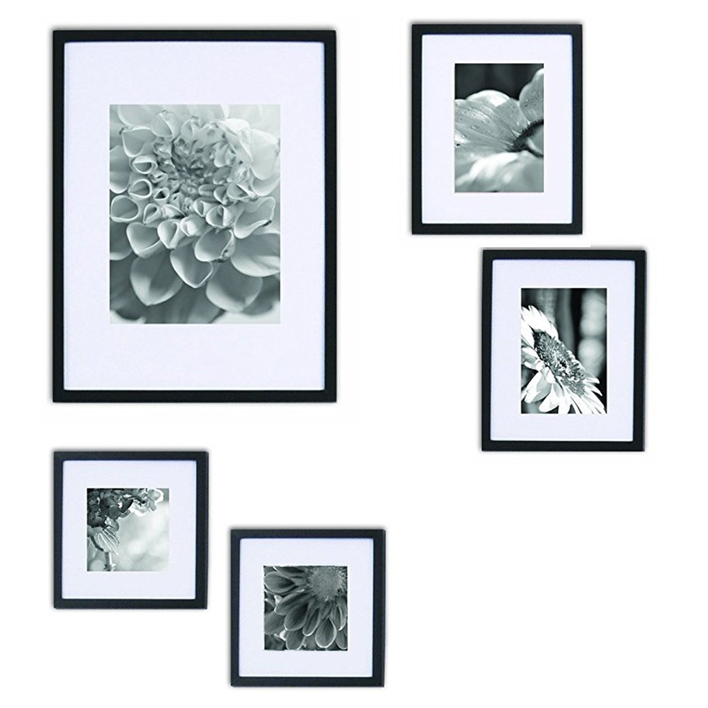 Gallery perfect 5 piece black wood photo frame wall for Picture hanging template kit