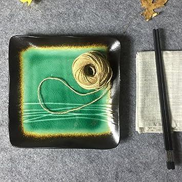 Vajilla Cubertería con estilo japonés y un pequeño cuenco de porcelana azul y blanco, platos