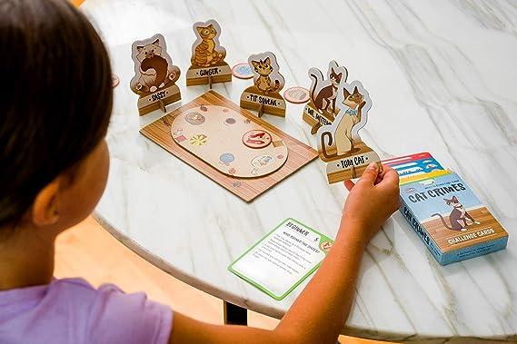 Think Fun Juego De Lógica De Crímenes De Gato: Amazon.es: Juguetes y juegos