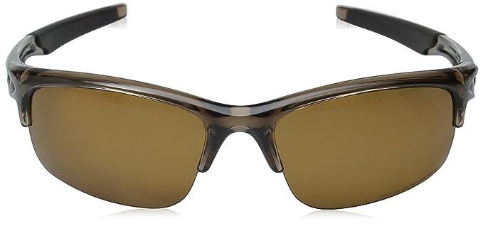 316a6ca6bf3 Amazon.com  Oakley Bottle Rocket Men s Polarized Active Sports Sunglasses  Eyewear - Brown Smoke Bronze   One Size Fits All  Clothing