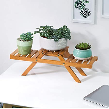 Puesto de plantas El soporte de flor de mesa de bambú de la Tres ...