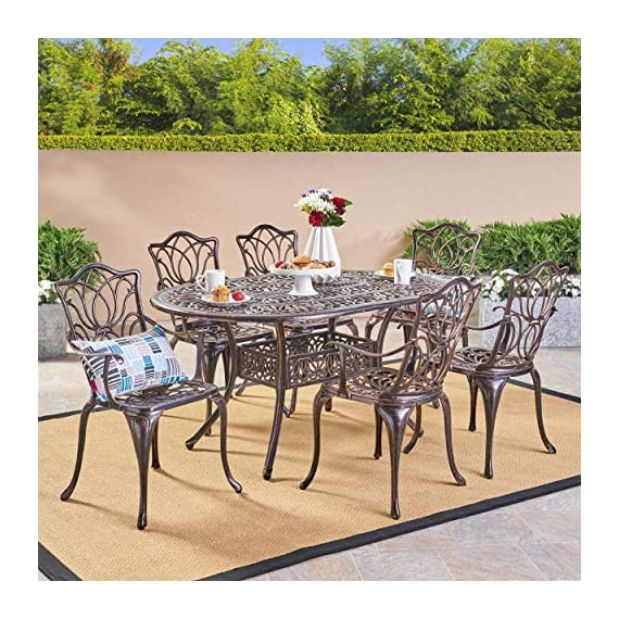 Christopher Knight Home Gardena Outdoor Furniture Dining Set, Table and Chairs for Patio or Deck in Copper (7-Piece Set) - 7-PIECE SET: Our dining set will meet all of your outdoor furniture needs. This high-class set includes 6 chairs and a table in a beautiful copper color, adding style to your space without sacrificing comfort. The chairs fit perfectly around the table for backyard family meals and picnics or lounging poolside with friends. RUST-RESISTANT METAL: At Great Deal Furniture, we bring you the best outdoor furniture available. Our table and chairs are made of sturdy and durable cast aluminum that is rust-resistant, for years of outside use. If you use this set by the pool, it's all-weather quality helps prevent water damage caused by wet swimsuits and splashing. INTRICATE ANTIQUE DESIGN: We created our Gardena furniture set with cast aluminum and a rustic and aged copper look that stays in good condition, for years of entertaining. Our classic design looks great with other yard and patio decor. - patio-furniture, dining-sets-patio-funiture, patio - 61T4mJl0 QL. SS570  -