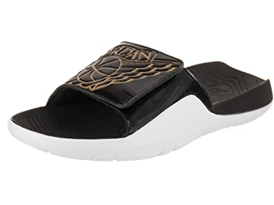 1cf69119712ea5 Amazon.com  Jordans Men s Hydro 7 Slide Sandals Black Metallic Gold ...