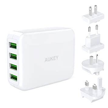 AUKEY USB Cargador con 4 Puertos de Adaptador de Viaje con Enchufe de Recorrido UK EU US AU Internacional Intercmbiable para iPhone X / 8 / 8 Plus, ...