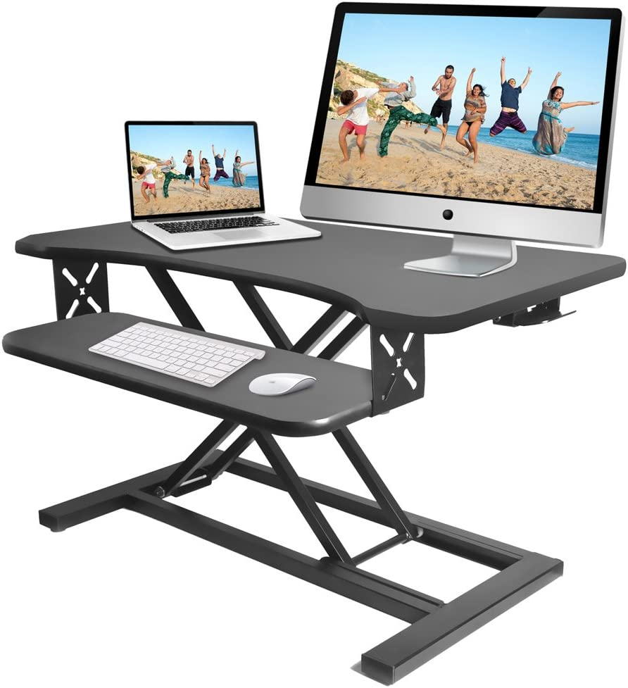 Pyle Ergonomic Standing Desk PC Monitor Riser – Height Adjustable Laptop Computer Table w Wide Keyboard Tray – Black Sit Stand Desktop Workstation Converter for Office or Gaming Use – PDRIS12
