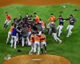 The Houston Astros, On The Mound Celebration Moments After Winning The 2017 World Series 8x10 Photograph Picture.