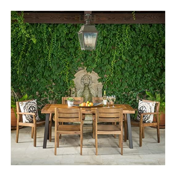 Christopher Knight Home 301108 Avalon 7 Piece Acacia Wood Dining Set with Rustic Metal Accents, Teak Finish - Includes: one (1) Table and six (6) chairs Table dimensions: 32. 25 inches deep x 69. 00 inches wide x 29. 50 inches high Chair dimensions: 22. 75 inches deep x 22. 75 inches wide x 33. 25 inches high Seat width: 17. 75 inches Seat Depth: 18. 75 inches Seat Height: 17. 75 inches Arm Height: 26. 25 inches Material: Acacia wood | Table leg finish: rustic metal - patio-furniture, dining-sets-patio-funiture, patio - 61TLsberEKL. SS570  -