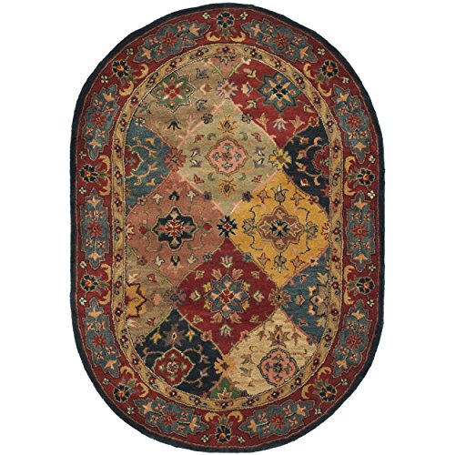 - Safavieh Heritage Collection HG926A Handcrafted Traditional Oriental Red and Multi Wool Oval Area Rug (7'6