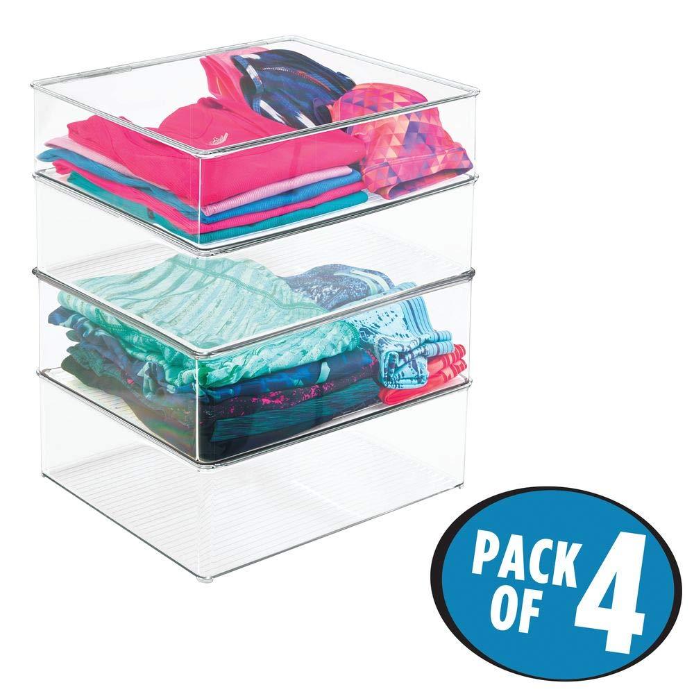 Conjunto de 4 cajas apilables de plástico duro con tapa.