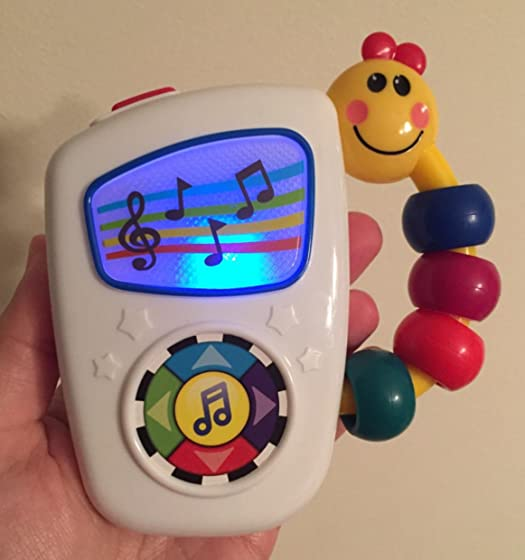 Baby Einstein Take Along Tunes Musical Toy, Ages 3 months + Didn't seem much of a good toy... at first.