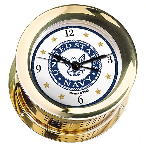 is Brass Quartz Ship's Bell Clock #NV200100 01C (#9 Emblem Printed in Full Color with Black Numbers, Gold Stars, and Navy Blue Border) ()
