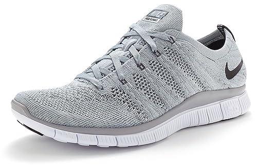 2086c91cd5fd9 Nike Men s Flyknit NSW Running Shoe (11.5) Grey  Amazon.ca  Shoes   Handbags