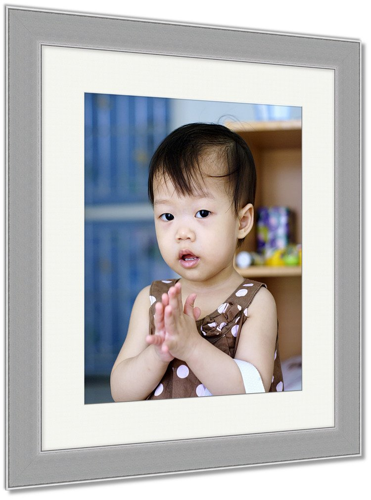 Ashley Framed Prints Thai Baby In Brown Dress Standing With Hands Clasped Sawasdee Thai Greeting In, Wall Art Home Decoration, Color, 35x30 (frame size), Silver Frame, AG5875564 by Ashley Framed Prints
