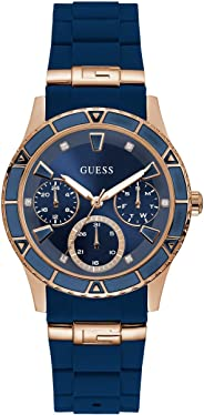 GUESS Rose Gold-Tone + Iconic Blue Stain Resistant Silicone Watch with Day, Date + 24 Hour Military/Int'l Time. Color: Blue