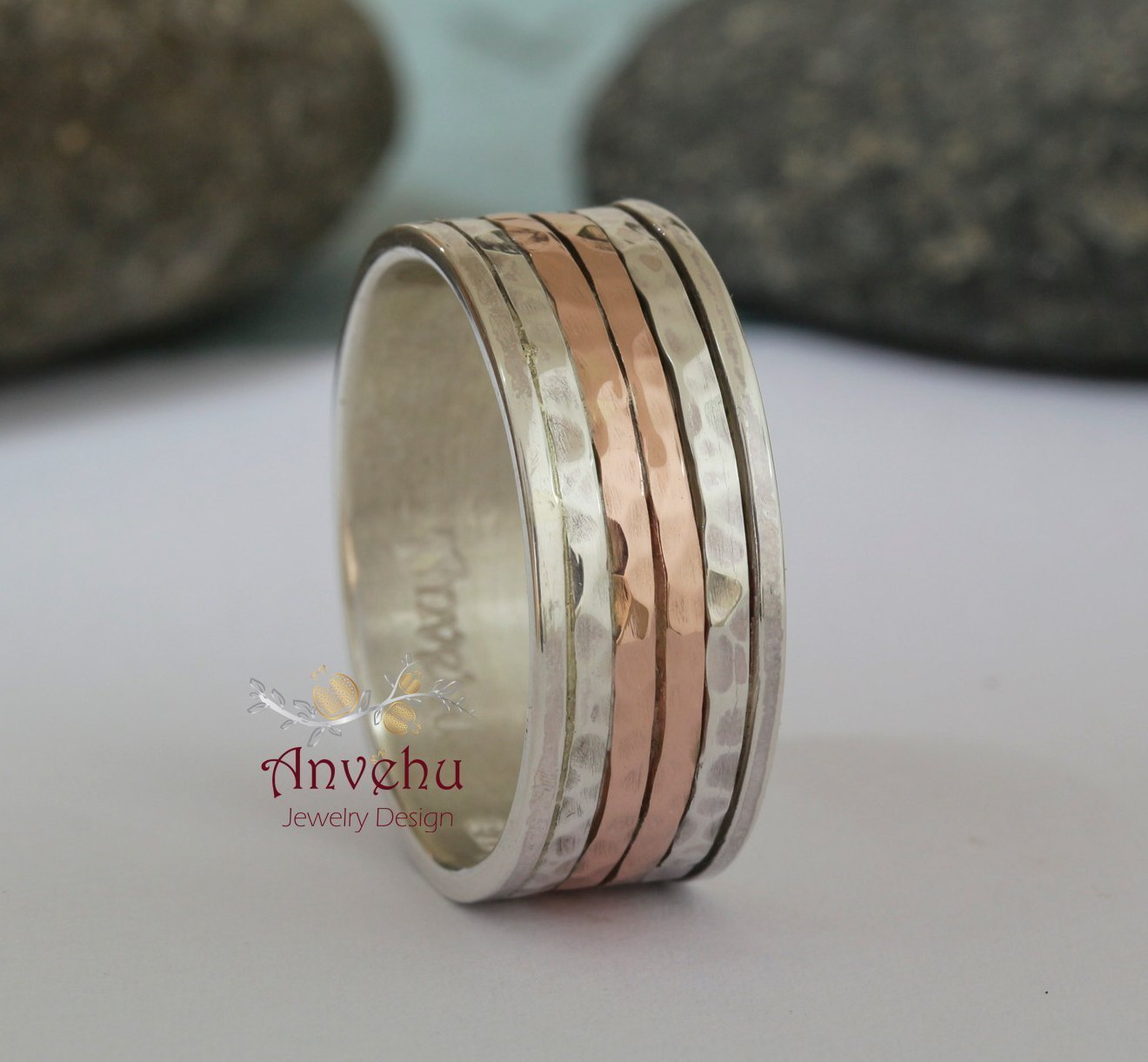 It is a photo of Mens Wedding Band Rose gold and Sterling silver band Hammered wedding band Men wedding ring Women wedding band 41.41mm Two tone band