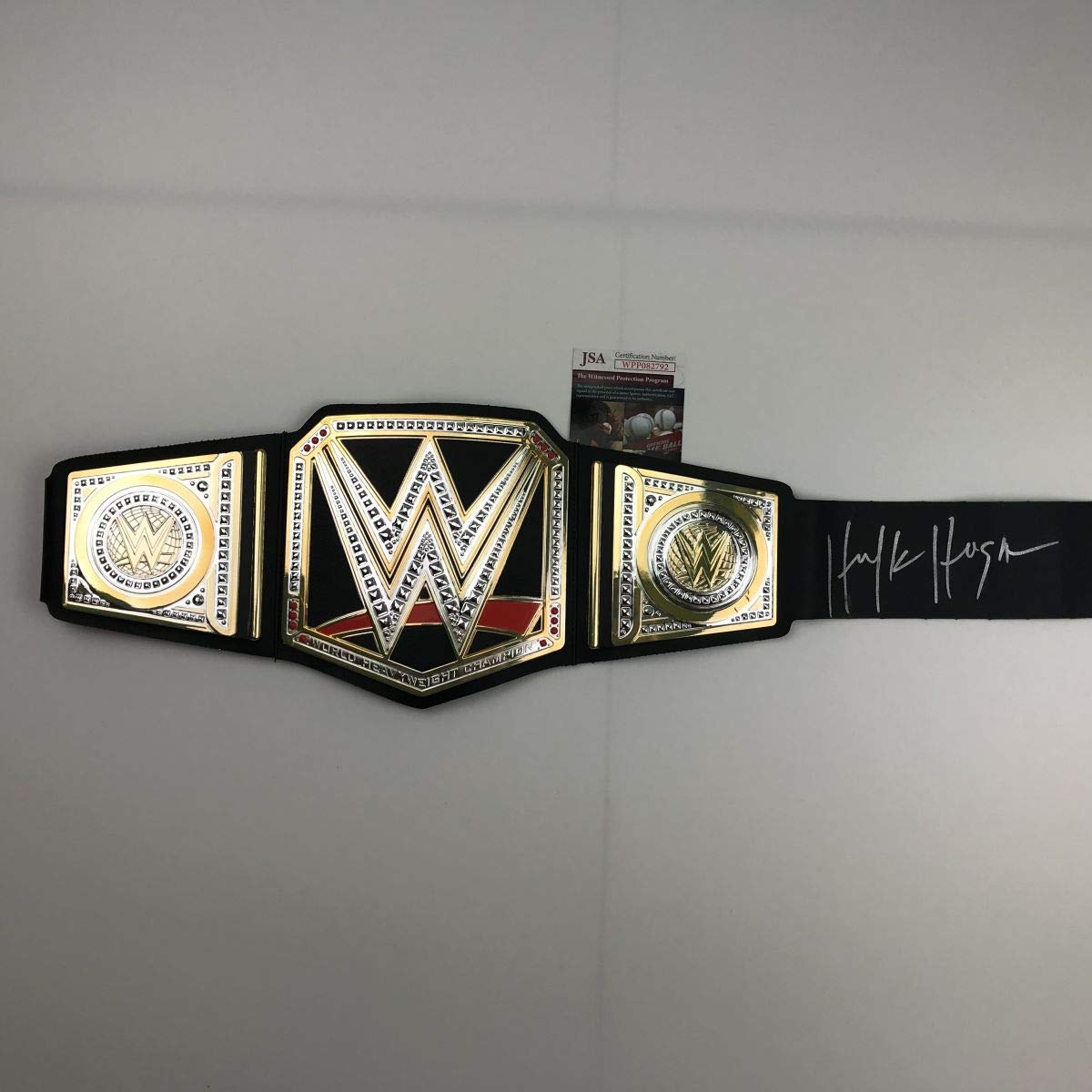 Autographed/Signed Hulk Hogan Black Replica WWE Wrestling Championship Title Belt JSA COA