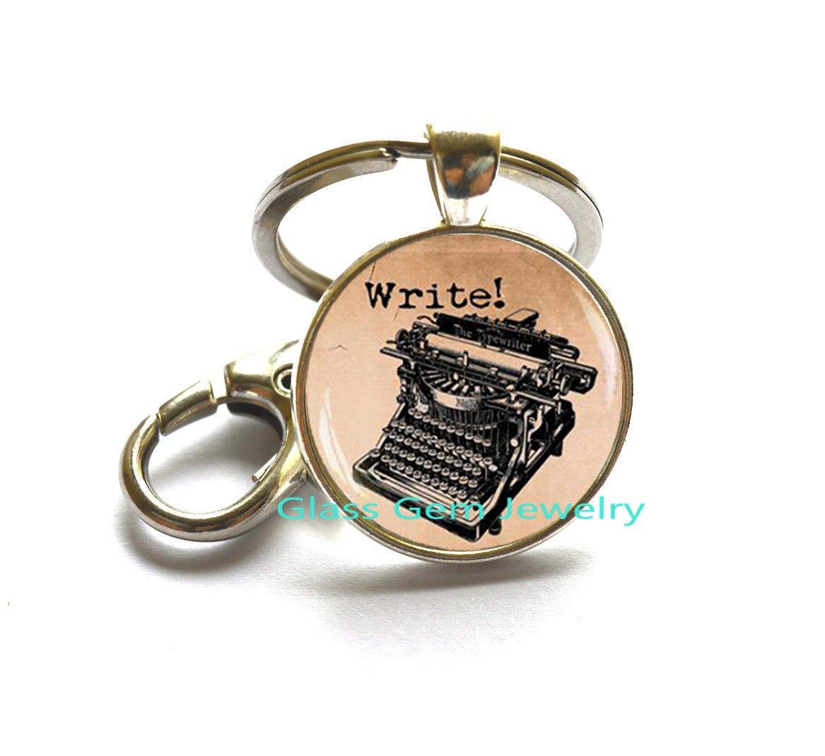 Old máquina de escribir llavero, llavero, diseño de máquina ...