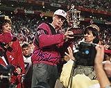 #4: Tom Osborne Nebraska Cornhuskers Autographed 8'' x 10'' Holding Trophy Horizontal Photograph - Fanatics Authentic Certified