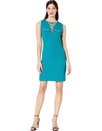 7a04a89575e bebe Women's Logo Lace-Up Mini Dress