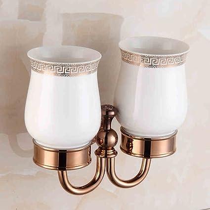 El portacepillos completo de cobre, el portavasos europeo de oro rosa, los vasos dobles