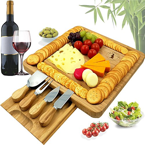 Bamboo Cheese Board and Knife cutlery Set with Hidden slide-out Drawer by La Mongoose. 4 Stainless-Steel Serving Knives Cracker Groove Large Cutting Plate Bread Meat Fruit Solid Perfect Gift Idea