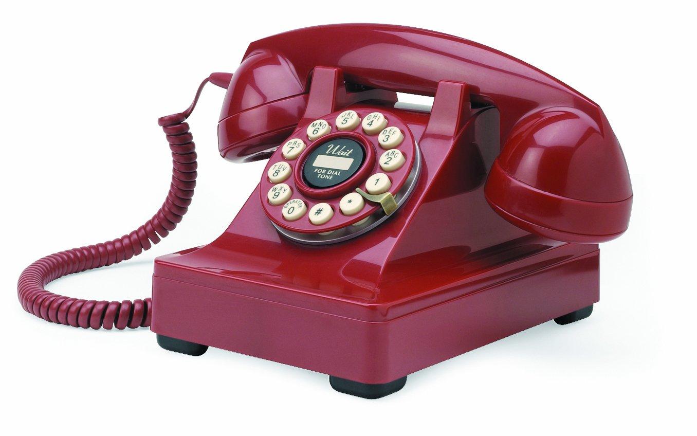 Teléfono telefono fijo retro con disco de marcar en el estilo sinuoso vintage antiguo (rojo) Todo de Rojo