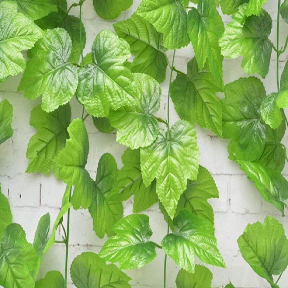 Le lierre artificiel laisse le feuillage vert laisse les plantes de vigne de feuillage pour le jardin de noce