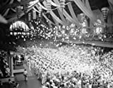 1937 photo School's out. Annapolis, MD. June 3. School's out for the graduating class at the Naval Academy at Annapolis, after receiving their diplomas the midshipmen are shown getting rid of their midshipmens caps for the headgear of an ensign. 6/3/37 Vi