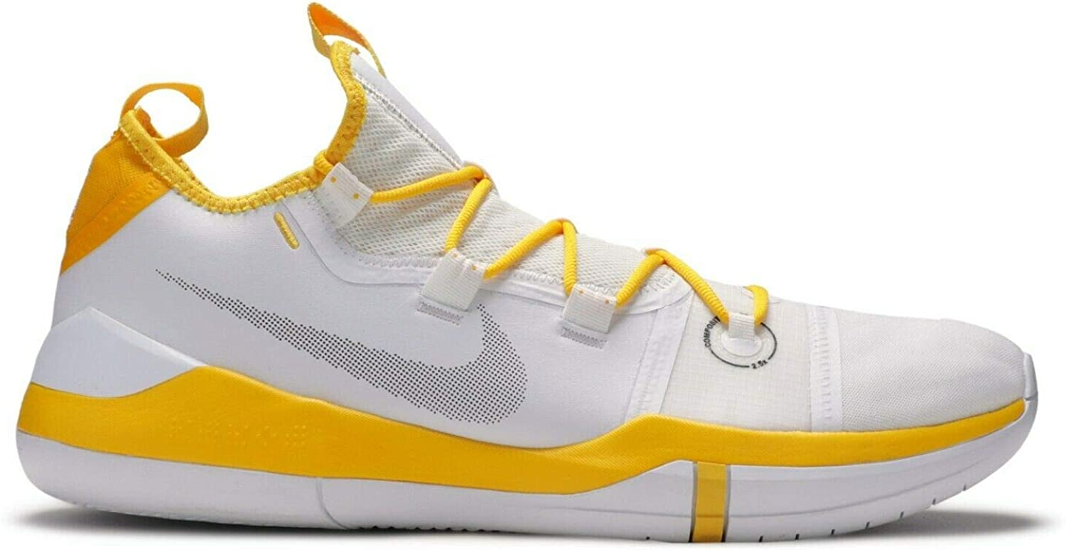 white and yellow basketball shoes