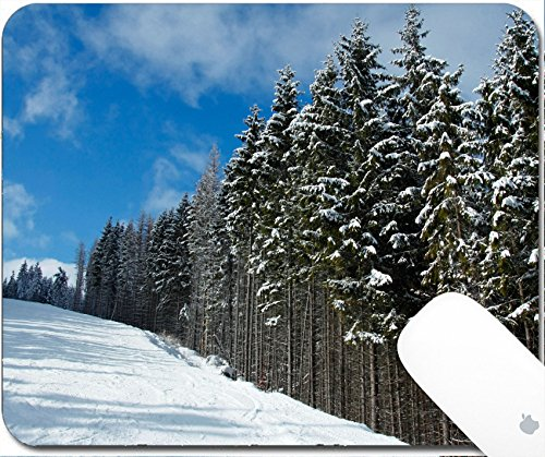 Luxlady Gaming Mousepad 9.25in X 7.25in IMAGE: 34022686 Ski slope and snow covered fir trees in Bukovel resort Ukraine (Ridge Track Scenic)