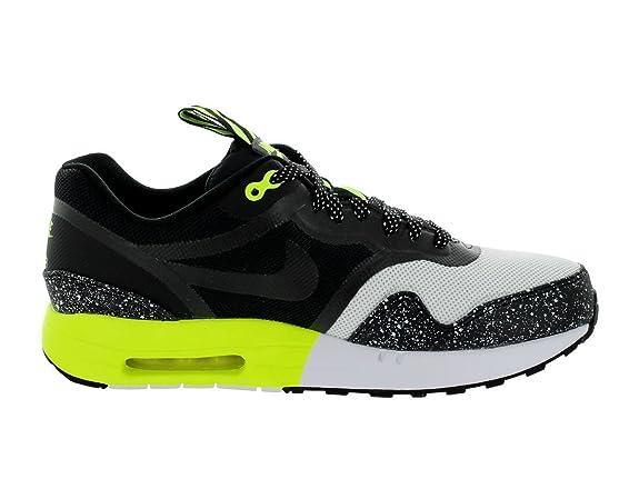 hot sale online 4929c 782fb Amazon.com   Nike Men s Air Max 1 PRM Tape Summit White Black Black White  Running Shoe 12 Men US   Road Running