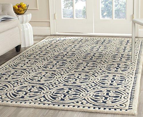 Safavieh Cambridge Collection CAM123G Handmade Moroccan Geometric Navy Blue and Ivory Premium Wool Area Rug (8′ x 10′)