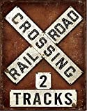 """Railroad Crossing Tin 2 Tracks SignTrain and railway enthusiasts will want to add this authentically-distressed sign to their displays and collections. Measures appx: 12.5"""" x 16"""". Predrilled and ready to mount."""