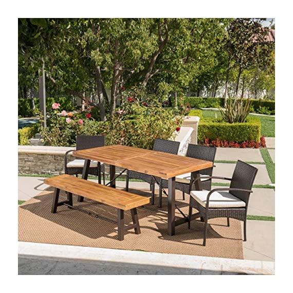 Christopher Knight Home Betsys Outdoor Acacia Wood Dining Set with Wicker Dining Chairs and Water Resistant Cushions, 6-Pcs Set, Teak Finish / Rustic Metal /  Multibrown / Crème - This clean and simple Dining set combines the functionality of wood and iron with the comfort of wicker. Complete with a Table, bench, and 4 wicker dining chairs, this set offers comfortable seating for 6 in the great outdoors. Sure to complement any patio décor, This Dining set offers you a stylish wooden design with the functionality of an iron framework and comfortable Wicker chairs,  to give you a weather resistant Set that will last your for years to come. Includes: one (1) Table, one (1) Bench, and four (4) chairs Table and bench material: Acacia wood table and bench frame material: Metal chair Material: Polyethylene wicker chair cushion material: Water resistant fabric composition: 100% polyester chair frame material: iron Table and bench finish: teak table and bench frame finish: rustic metal wicker finish: Multibrown cushion color: crème assembly required Hand crafted details Table dimensions: 33. 00 inches deep x 70. 00 inches wide x 29. 50 inches high bench Dimensions: 14. 50 inches deep x 63. 00 inches wide x 17. 75 inches high Seat width: 14. 57 inches Seat Depth: 63. 00 inches Seat Height: 17. 72 inches Chair dimensions: 23. 50 inches deep x 22. 10 inches wide x 32. 75 inches high Seat width: 18. 25 inches Seat Depth: 18. 25 inches Seat Height: 16. 50 inches Arm Height: 24. 60 inches - patio-furniture, dining-sets-patio-funiture, patio - 61W25loVxbL. SS570  -
