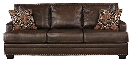 Ashley Furniture Signature Design  Corvan Contemporary Faux Leather Sofa  With Nailhead Trim Antique Antique Leather Sofa N66