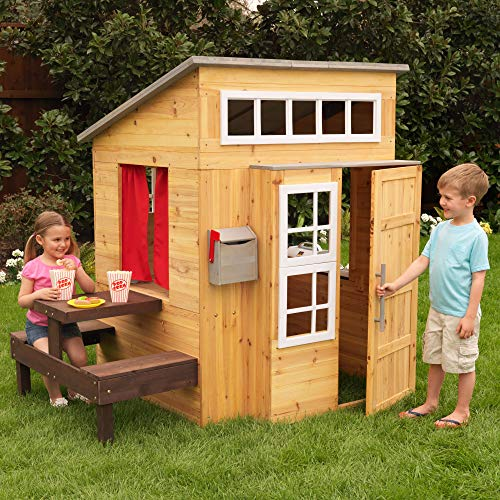 Outdoor wooden playhouse with picnic table