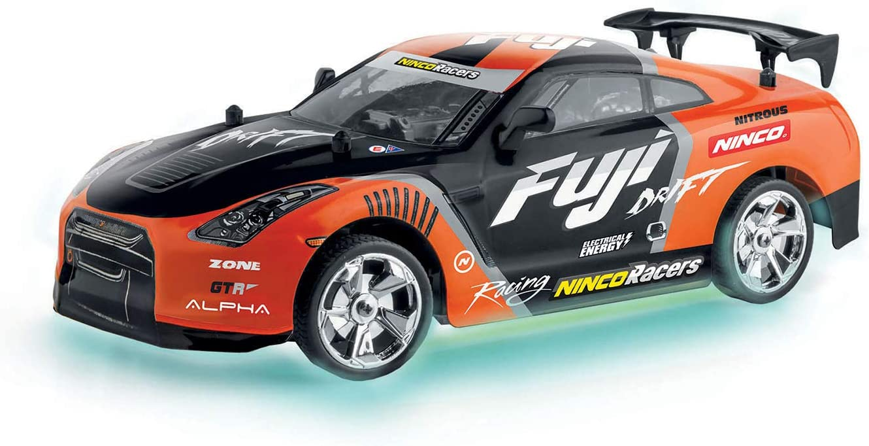 Ninco, emis NincoRacers Fuji Coche para campeonato de Drift con luces de neón en la parte baja del chasis efecto suelo, emisora 2.4GHz. (NH93114), color naranja y negro